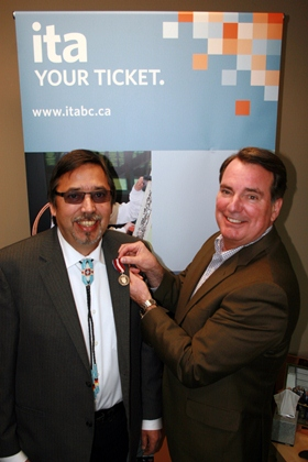 Gary McDermott with Kevin Evans receiving Queen's Jubilee Medal